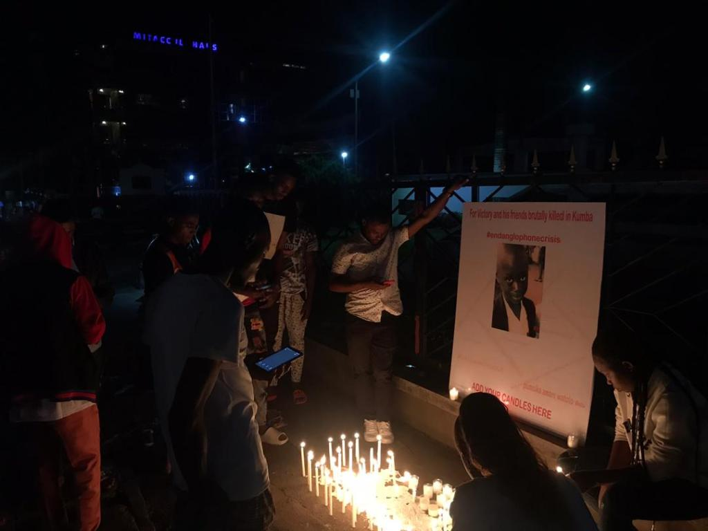 Cameroonians mourn victims of the Kumba school shooting, in memorial candle lighting ceremony (Picture: @KreativeKwame)