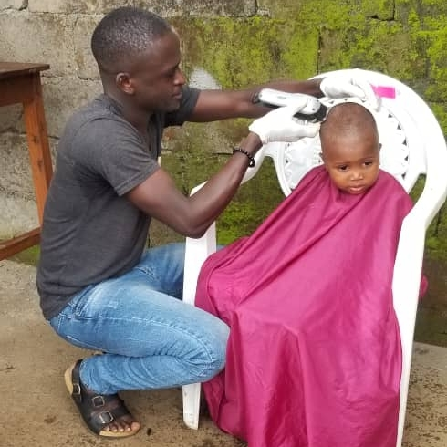 Less Privileged Enjoy Free Haircuts From MobileBarber